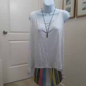 White casual top with lots of color in the back
